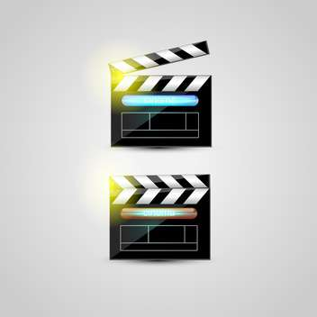 two clapper boards on grey background - vector gratuit #128018