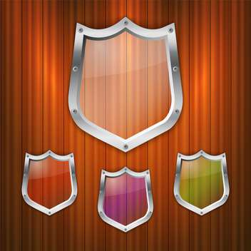 Vector set of glass shields on wooden background - vector #131658 gratis